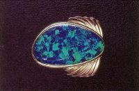Fig. 13. A ring-mounted black Lightning Ridge-type composite doublet opal. (Photograph, G. Brown)